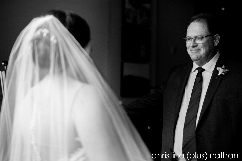 Father of the bride sees her for the first time at her Sheraton Eau Claire wedding