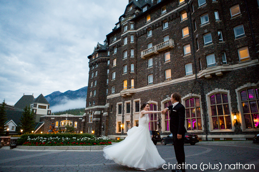 Newlyweds dance outside the Fairmont Banff Springs Hotel