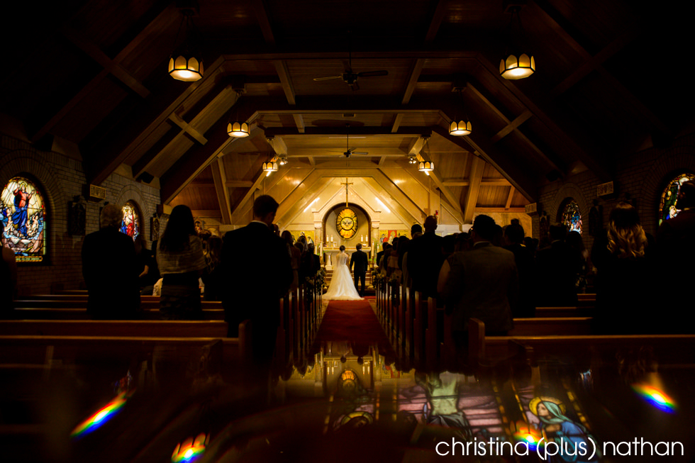 Photo of a wedding ceremony at St. Mary's Parish, Banff, photographed by christina (plus) nathan photography