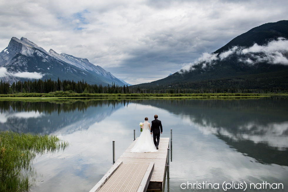 Bride and groom photographed at Vermillion Lakes, Banff