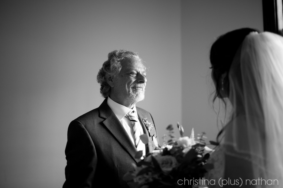 Father of the bride sees her for the first time before her Fort Calgary wedding