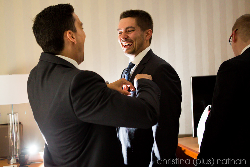 Groom gets ready for his Royal Glenora Club Edmonton wedding photographed by christina (plus) nathan photography