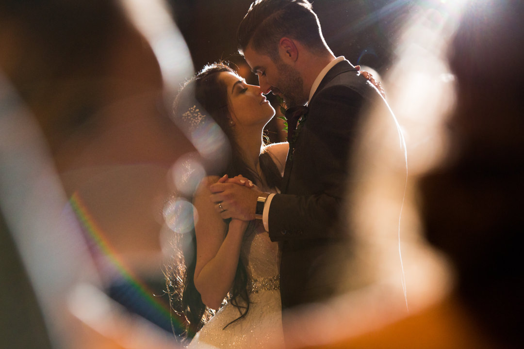 Newlyweds share their first dance at the Hotel Arts Calgary wedding venue