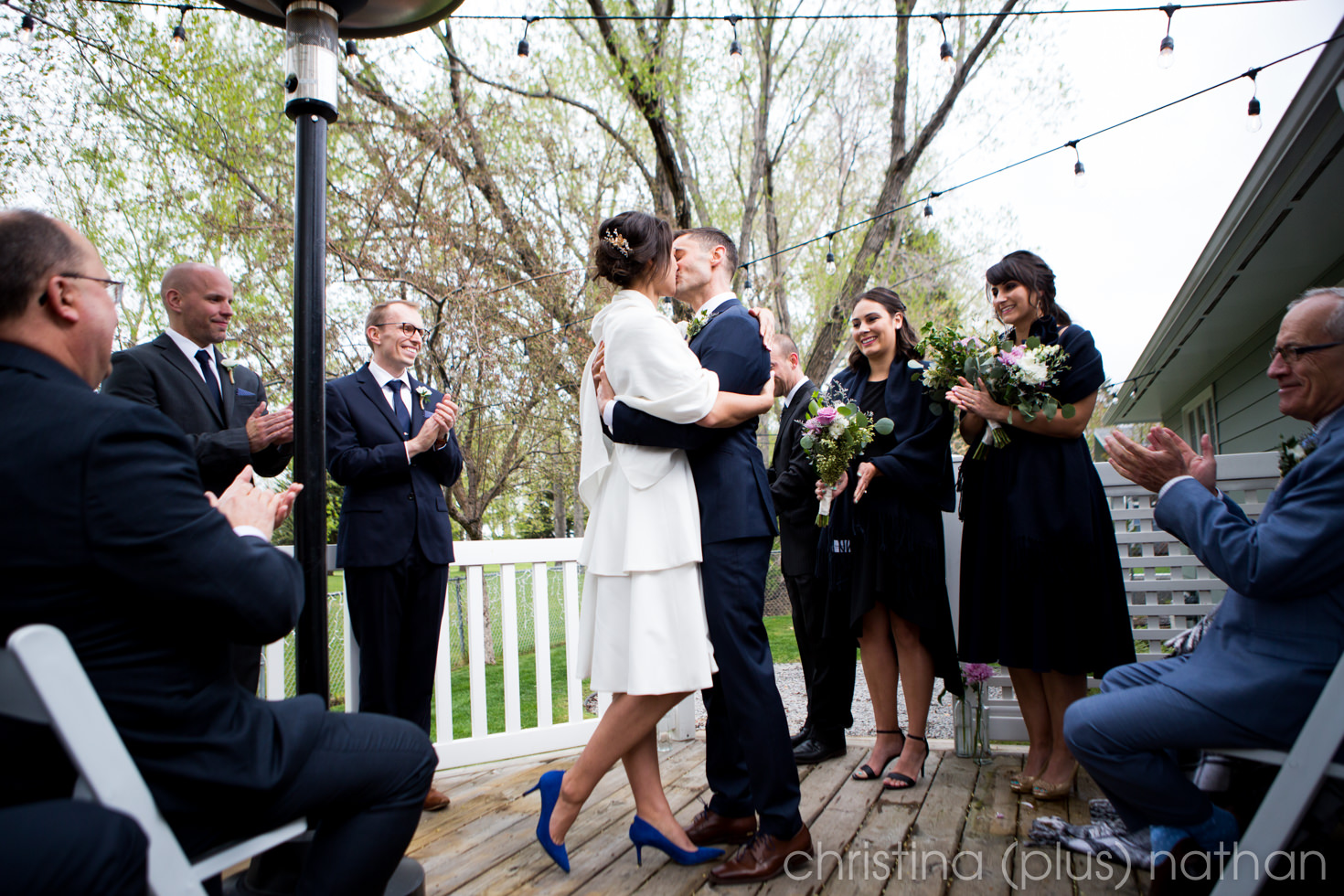 Adele and Brendan share their first kiss at their Calgary intimate backyard wedding